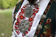 Bunad embroidery decorated with very Large, medium, to small at neck - Solje, made of Silver filiigree,  usually w/hanging gold teardrops.  Lovely