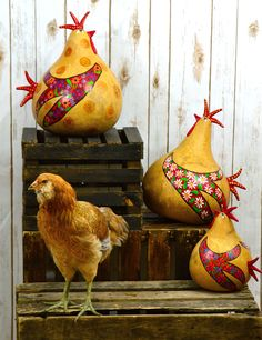 Aurora shows off my new gourd roosters. www,gourdament.etsy.com