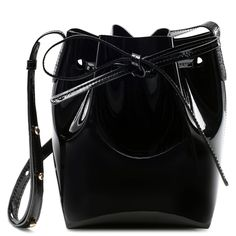 Italian patent leather blush mini mini bucket bag with blush interior matte patent. Adjustable strap. Made in Italy.