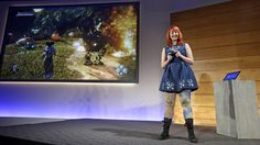 Lauran Carter, of Lionhead Studios, demonstrates a video game at an event demonstrating new features of Microsoft's Windows 10 at the company's headquarters Wednesday, Jan. 21, 2015, in Redmond, Wash -  #thalo, #getinspired