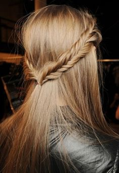 Fishtail braids on the side put together in the back