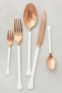 The One Thing Your Dinner Is Missing #refinery29 http://www.refinery29.com/dipped-flatware-home-decor-trend#slide-1 Copper and white for breakfast. Gwyneth would approve.