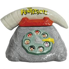 This fun, ceramic cookie jar comes in the shape of a turn-dial telephone, and features all your favorite characters from the #Flinstones. #HannaBarbera