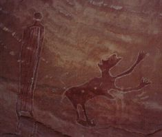 Rock Art in the San Rafael Swell, Utah. [Possibly depicts a person and a dog? JE]