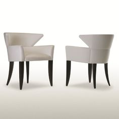 Wolk Chair.    A very elegant classically modern pull-up chair curved to hug your body for secure comfort. The Wolk Chair designed by Michael Wolk is applicable for almost any environment.