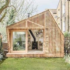 Garden room architecture Wooden Writers Shed in Hackney in Garden Shed Ideas. This alluring writers shed in Hackney, east London, was designed by Surman Weston architects for a client who loves childrens literature and mythology Small Space Living, Small Spaces, Work Spaces, Espace Design, Tiny Office, Home Office, Tiny House Swoon, Garden Office, Backyard Office