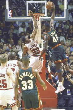 Shawn Kemp dunking all over Scottie Pippen, one of the leading ladies of the NBA.