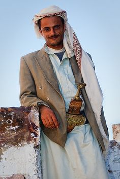Yemeni shepherd wearing a janbiya, a dagger and traditional accessory for men, in the Shihara Mountains of Yemen