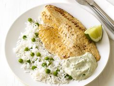 Tilapia Masala with Rice : Tilapia is a quick-cooking, mild-flavored fish that also happens to be budget-friendly. Try it flavored with Indian spices and served simply, with rice.