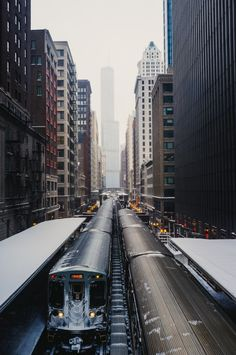 I think this is Chicago. The elevated train does not go through the tall buildings like that anywhere in NYC, and I think that's the Sears Tower in the background.