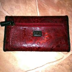 Large Maroon Paisley faux leather Relic wallet NWOT Beautiful faux leather Relic brand wallet /pocketbook. Gorgeous paisley design, deep maroon color with dark brown trim and inside Zipper pocket on the back,& one inside with lots of card slots and space!  *3rd photo has a weird line down the side and idk how it got there lol. But shows all pockets and cleanliness!  Open to offers!  Bundle and save! Relic Bags Wallets