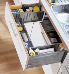 Clever way to organize under the sink--eliminates that wasted space