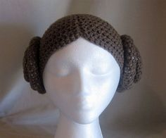 Crocheted Princess Leia hat/wig. I'd be curious to see how this actually looks on a real person with real hair. Seems like it would be tough to cram your own hair under this (especially if you have long hair). Still, very awesome!