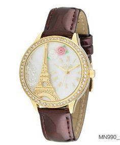 Reloj colección París con pieza en relieve.