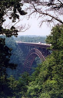 Wild, Wonderful West Virginia!!          The New River Gorge Bridge is a steel arch bridge 3,030 feet long over the New River Gorge near Fayetteville, West Virginia.  Love Bridge Day.  I have rafted through the rapids under this!!