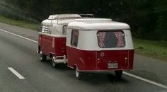 An Eriba Puck,  German built  travel  trailer,  with 60s VW bus.