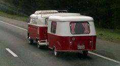 An Eriba Puck,  German built  travel  trailer,  with 60s VW bus.