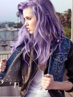 Messy Wild Lavender Hair. Denim studded vest over a black leather jacket. At the beach. Who tf is this chick!? A badass bitch.