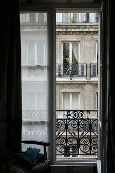 Open the window, let your dreams soar...  A window in Paris.