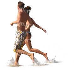 A man and woman running hand in hand into water