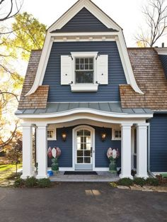 Lake Minnetonka Cottage front... I love the dark blue color with the white accent. A little gray dry stack stone would be amazing!