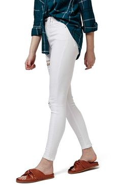 Free shipping and returns on Topshop 'Jamie - Super Ripped' High Waist Skinny Jeans (Petite) at Nordstrom.com. Frayed holes further the playfully punky style of high-rise skinny jeans cut from soft, power-stretch denim in a bright white wash.