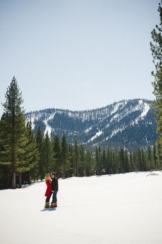 sledding & snowy cabin engagement photos