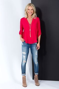 Distressed jeans  red blouse  suede booties