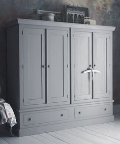 This most practical classic wardrobe is manufactured in solid pine throughout dovetailed drawers with a wooden hanging rail in each side of the