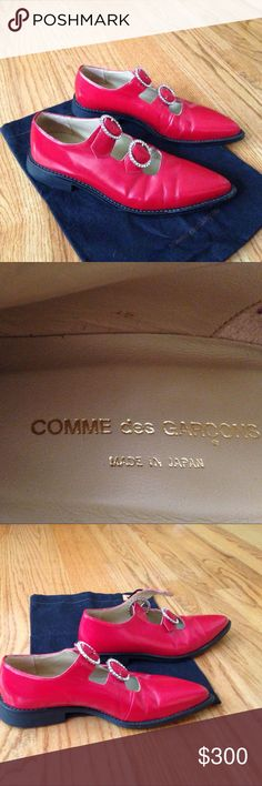 Designer shoes Made in Japan by Comme des Garçons. Color is red shoes have silver buckles with Swarovski crystals. Worn to meta Galla events 1  times. Size on bottom says 24 1/2. Purchased these at a new York city sample sale retail value $1500. USA size would fit 7 1/2 to 8 1/2. One shoe has some small back scuff marks   Afraid to clean the scuff marks because the shoes are so expensive. Comme des Garcons Shoes Flats & Loafers