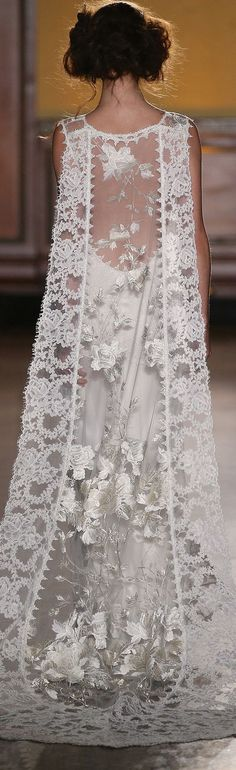 The Whitney cape train by Claire Pettibone  https://couture.clairepettibone.com/collections/the-gilded-age-wedding-dresses/products/whitney