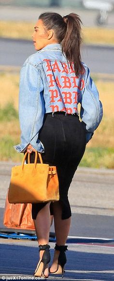 kim kardashian lands back in la after trip to miami with kanye west and north daily mail online