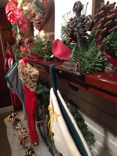 How to hang multiple stockings with 3 stocking holders and a curtain rod. I bought the stocking holders at Hobby Lobby for about $6 each and the curtain rod at Walmart for about $4. I have another picture that shows the stockings hanging on this way. I fit 6 stockings on my mantle, but you can fit a lot more!