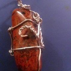 Red Jasper and silver colour wire.