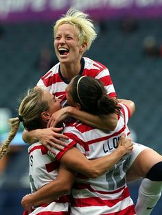 Carli Lloyd (R) of USA celebrates with team-mates Megan Rapinoe (C) and Heather Mitts after scoring their third goal during the Women's Football first round Group G match between United States and Colombia on Day 1 of the London 2012 Olympic Games at Hampden Park on 28 July.