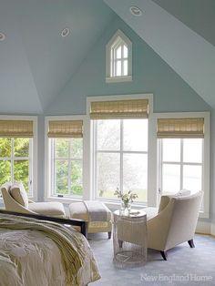The master bedroom's motorized shades , windows, carpet