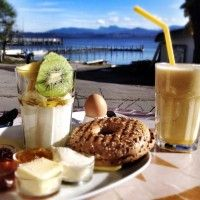 """Chiemsee Coffee. Perfect place to have a delicious bagel and a cappuccino with Rosenheim's Dinzler coffee. """"Bavarian sea view"""" included."""