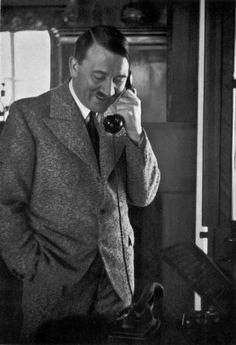 A smiling Adolf Hitler at the telephone