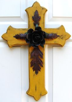 Bold yellow wooden cross accented with rustic rose and leaves, hand-crafted and designed by DiaMor De'cor