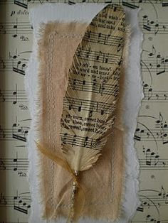 Feathers made from old hymnals or sheet music.... how clever and what a great way to make something old, new again!  Todolwen: feathers