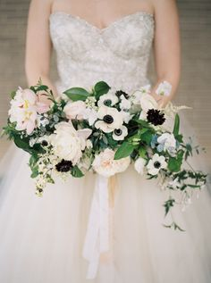 Anemone and peony crescent bouquet: http://www.stylemepretty.com/2015/08/08/25-bouquets-that-will-convince-you-to-blow-your-budget-on-florals/