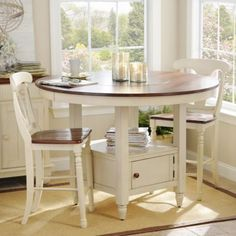 Imagine this in your #kitchen! Our gorgeous British Isle Ivory Round Gathering Table has a built-in Lazy Susan for serving convenience! #kirklands #eCatalog