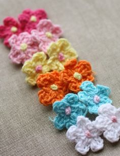 Darling Blooms - 75% off  at The Plaid Barn Each set includes 6 handmade mini crochet flowers – one in each 6 colors!     You'll receive 6 mini crochet flowers each measuring approx. 5/8″:     1 – Festive Fuschia with yellow center   1 – Pale Pink with yellow center  1 – Lemon with pink center  1 – Juicy Orange with yellow center  1 – Baby Blue with pink center  1 – Classic White with pink center