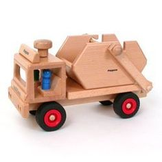 "Fagus Wooden Skip Dump Truck - Made in Germany by Fagus. $58.51. Made inGermany of beech wood.. For indoor play only.. Includes: 1 skip and 3 peg figures. Steerable For Little Hands. Sturdy 13"" long Skip truck. Steerable wooden skip truck, with one skip and three figures. The ""arm"" descends to catch on the removable skip, and then draws it on to the back of the truck. Fill the skip up with pebbles, sand or whatever load you need to cart away and then haul it off!"