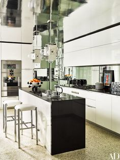 The kitchen has a Caesarstone island and silver mylar on the ceiling.