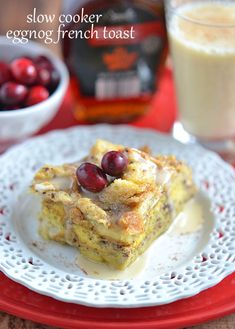 Make your holiday breakfast stress-free with this Slow Cooker Eggnog French Toast.  Serve this perfectly spiced and decadent breakfast casserole with traditional maple syrup, or indulge with a drizzle of eggnog icing! | Kitchen Meets Girl