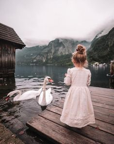 feeding the swans at the beautiful Austrian village of Hallstatt ✨ by Cute Kids, Cute Babies, Baby Kids, Kids Fashion Photography, Children Photography, Amber Fillerup, Kid Styles, Swans, Baby Love