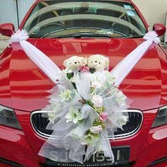 White Teddy Bear flowers on red wedding car