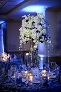 Tall centerpieces with white flowers - wedding