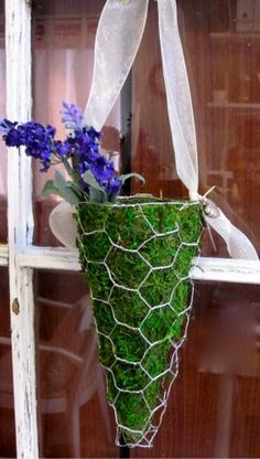 Moss and chicken wire decorative cone.